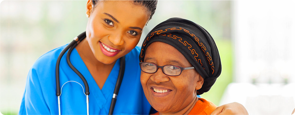 A caregiver and a patient smiling